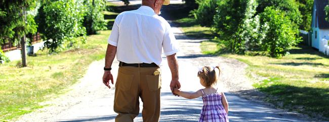 Grandparent walking baby